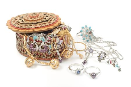 Wooden box with yellow and white gold jewelry, on white photo