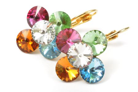 Beautiful golden earrings with colorful stones photo