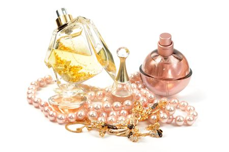 Perfumes , gold set and pearl necklace, isolated Stock Photo - 7625579