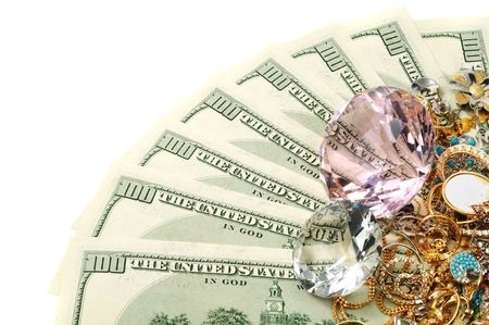 Dollars , jewelry and diamonds on white background