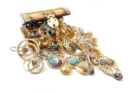 Wooden chest full of gold jewelry, isolated on white