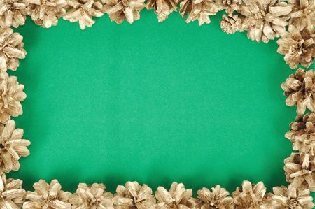 Green christmas background with gold cones frame photo
