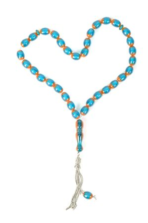 Muslim rosary beads, isolated on a white background photo
