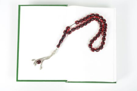 Muslim rosary beads on the Holy Quran photo