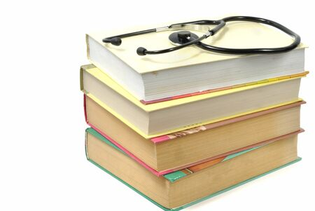 stock of books and stethoscope isolated on white background photo