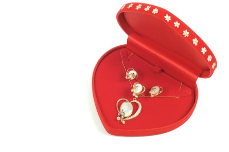 Gold jewelry set with pearls in red open box photo