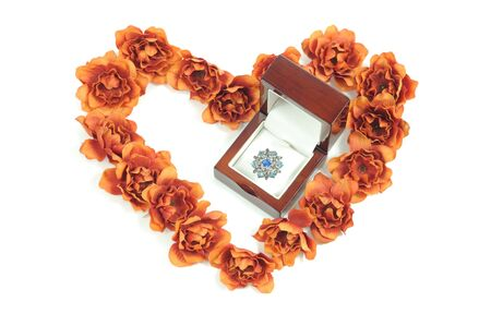 beautiful ring in wooden box and heart from flowers Stock Photo - 8855631