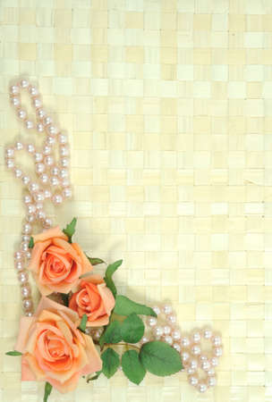 Framework on wooden background from roses and pearls photo