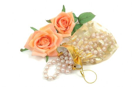 Pearl necklace and roses on a white background photo