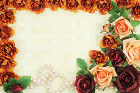 Frame from flowers on wooden background photo