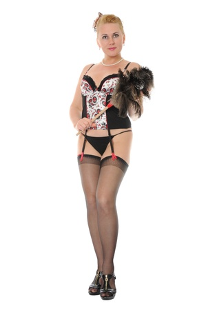 Beautiful woman in lingerie, stockings and garter belt holding feather duster Stock Photo - 9302705