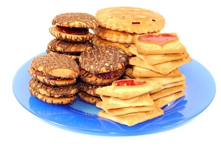 Cookies on a blue plate , isolated on a white background Stock Photo - 9302747