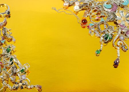 Jewelry from white gold,  isolated on gold background photo