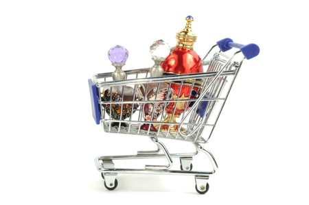 perfume oil: Shopping card with perfumes in it isolated on a white background