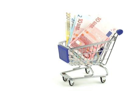 Shopping card with dollars and euro, isolated on a white background photo
