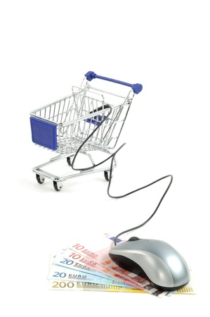 Shopping card with computer mouse on dollars and euro, isolated on a white background photo