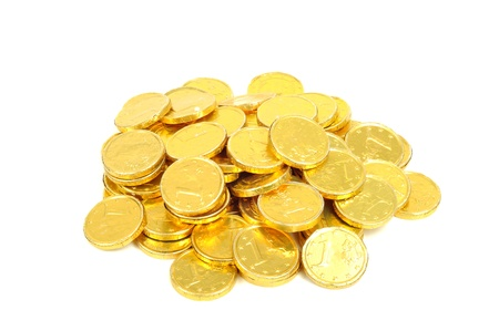 golden glow: Gold coins of one euro, isolated on white