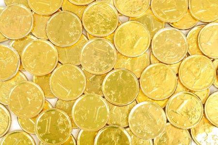 Gold coins of one euro background, isolated on white photo