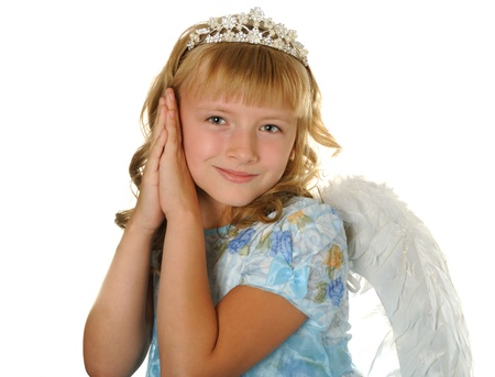 Happy girl with diadem and angel wings, isolated on white photo