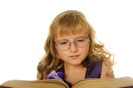 Girl with glasses reading big book, isolated on white Stock Photo - 10181888