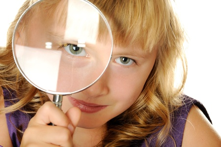 Smart  girl with magnifying glass, isolated on white Stock Photo - 10181893
