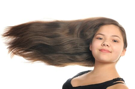 Beautiful happy girl with long hair, isolated on white Stock Photo - 10274664