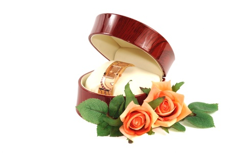 Woman fastion watch in wooden box and roses photo