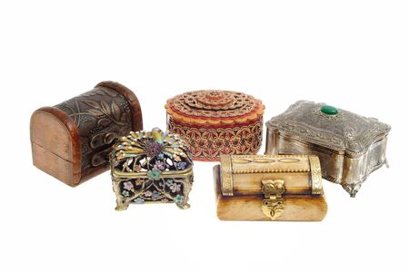 Set of jewelry wooden and metal boxes, isolated on white background photo