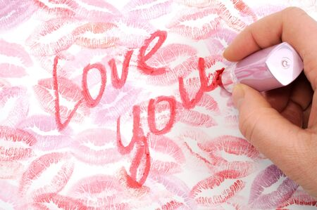 Print of lips kisses with words love you on it, close up photo photo