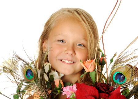 Happy smilyng girl with flowers , isolated on white photo