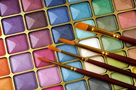 eye make up: Decorative colorful eyeshadow and brushes , close up shot Stock Photo