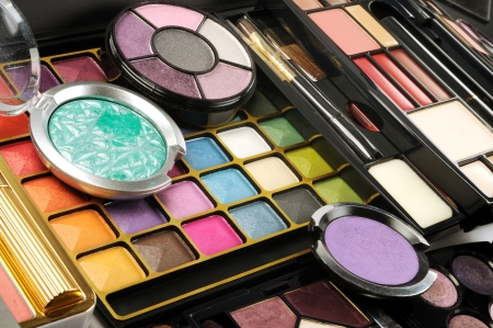 cosmetic cream: Lot of decorative colorful makeup sets , close up shot