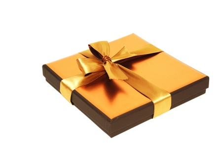 Gift box with gold  ribbon, on a white background photo