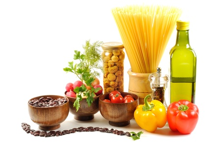 Vegetables , oil, pasta,  and different spice,  on a white background