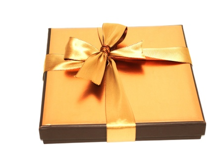 Gift box with gold  ribbon, on a white background Stock Photo - 11173598
