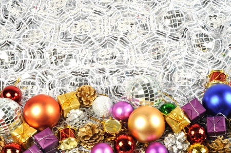 Christmas border with colorful balls , gifts and fir golden cones Stock Photo