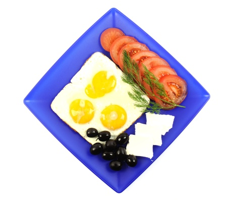 Three fried eggs on a blue plate, on a white background Stock Photo - 11545586