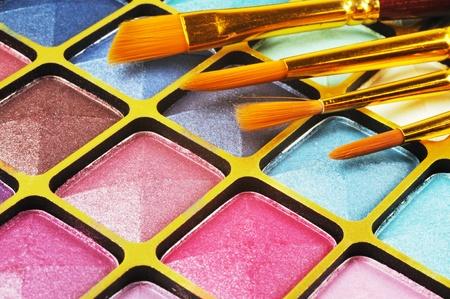 Decorative colorful eyeshadow and brushes , close up shot Stock Photo - 11932322