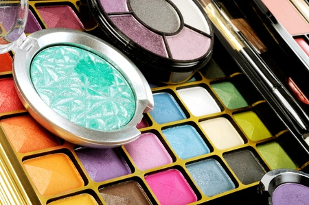 Lot of decorative colorful makeup sets , close up shot photo