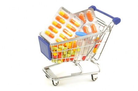 Shopping cart with medecine pills on a white background