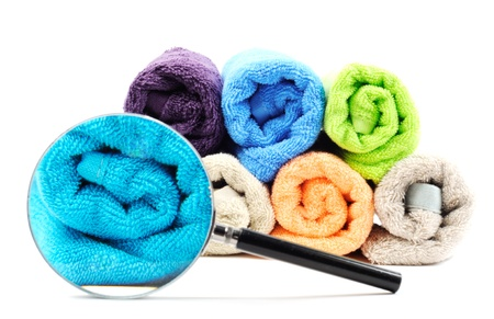 Pure cotton towels and magnifying glass  , on a white background photo