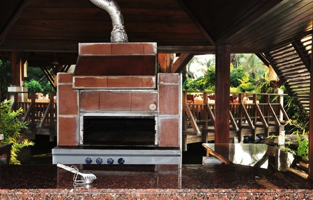 Outdoor cooking stove and fireplace in a resort hotel photo
