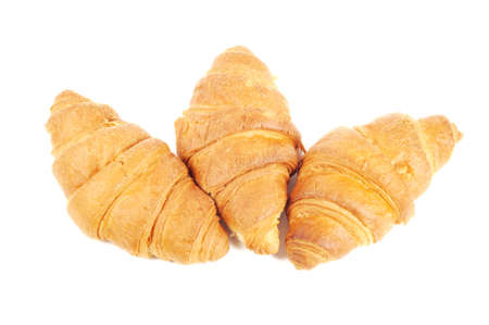 Four french croissants on white background Stock Photo - 13020637