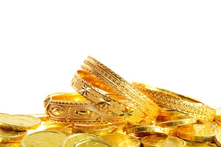Gold coins and bracelets on a white background, Stock Photo - 13020837