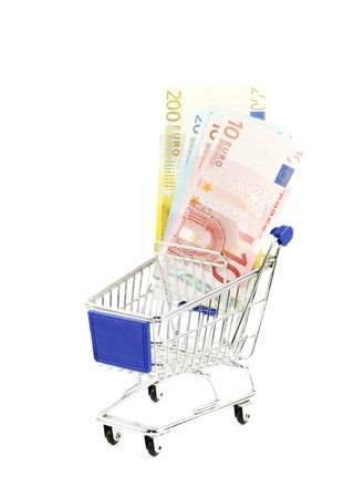 Shopping card with dollars and euro, on a white backgraund photo