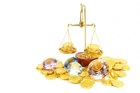 Gold coins of one euro and diamonds with scale, on white Stock Photo - 13071510