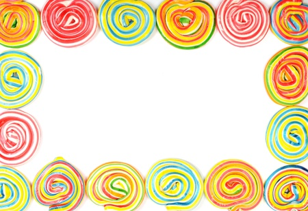 A lot of colorful lollipops , frame with white background photo