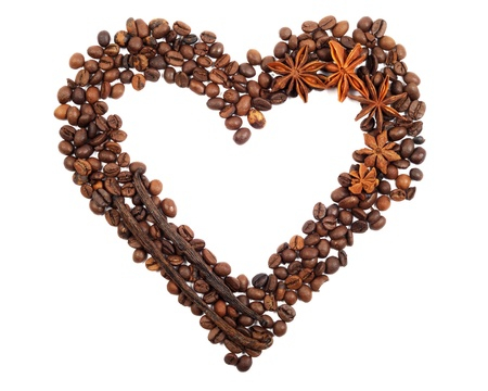 Heart from coffee beans , on  a white background photo
