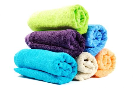 Stack of cotton colorful towels  , on a white background photo