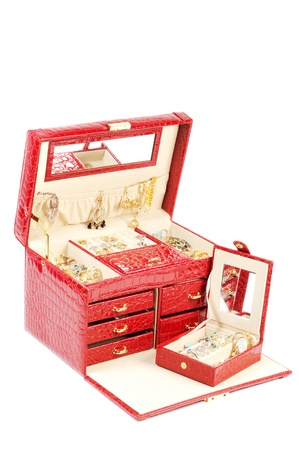 An open jewelry box with gold and platinum  jewelry   on a white background Stock Photo - 13338793